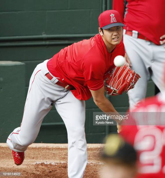 Shohei Ohtani of the Los Angeles Angels throws in the bullpen before a game against the Texas Rangers in Arlington Texas on Aug 18 2018 ==Kyodo