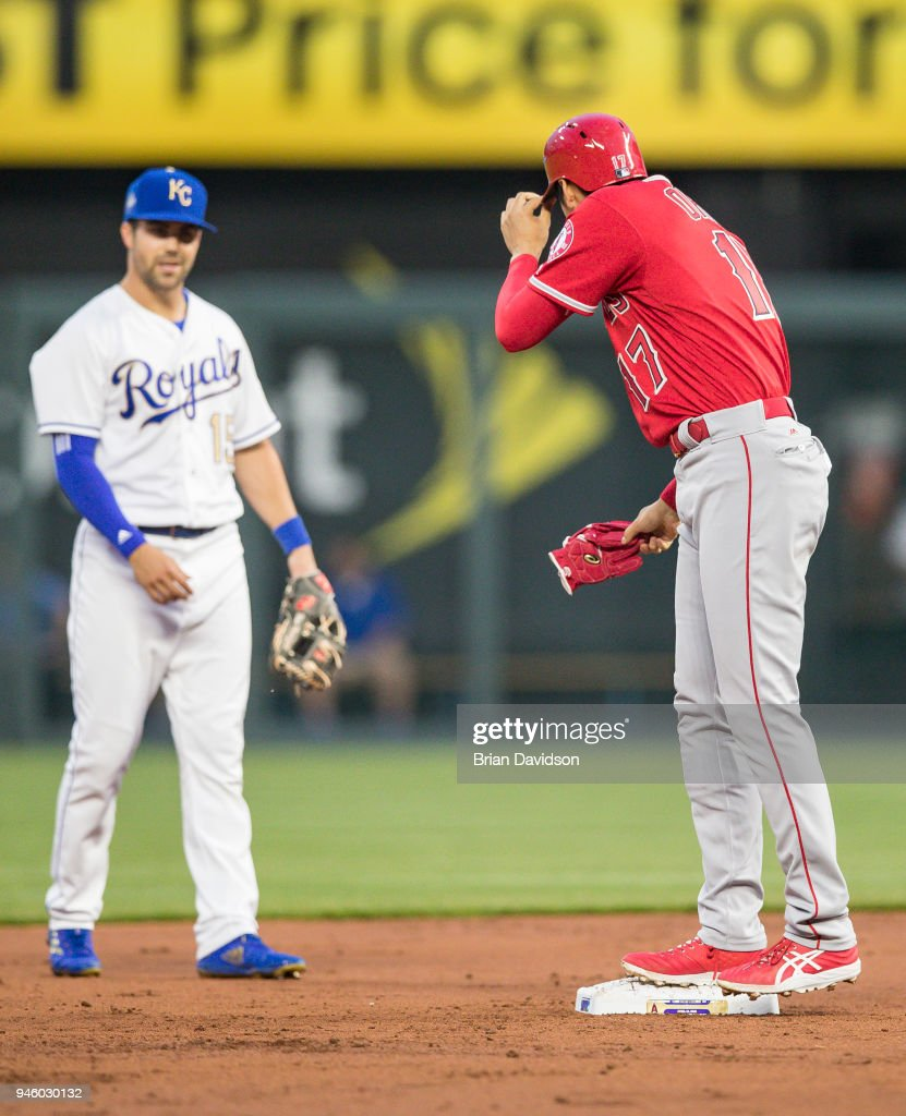 Shohei Ohtani #17 of the Los Angeles Angels tips his hat to Whit Merrifield #15 of the Kansas City Royals during the second inning at Kauffman Stadium on April 13, 2018 in Kansas City, Missouri.
