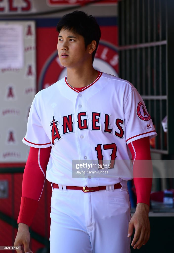 Shohei Ohtani #17 of the Los Angeles Angels waits to go to bat in the dugout during the game against the San Francisco Giants at Angel Stadium on April 22, 2018 in Anaheim, California.