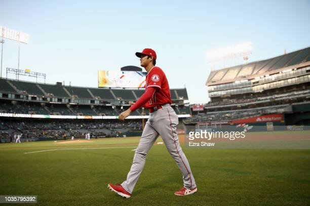 Shohei Ohtani of the Los Angeles Angels walks back to the dugout before their game against the Oakland Athletics at Oakland Alameda Coliseum on...