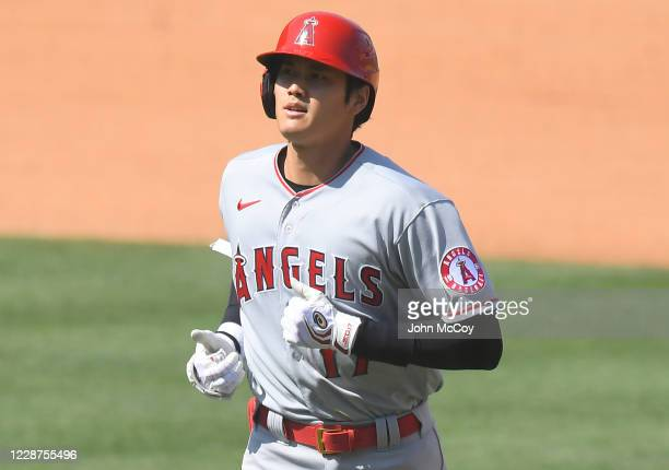 Shohei Ohtani of the Los Angeles Angels walks back to the dugout after flying out in the sixth inning agains the Los Angeles Dodgers at Dodger...