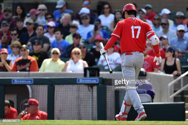 Shohei Ohtani of the Los Angeles Angels walks back to the dugout after striking out in the second inning of the spring training game against the...