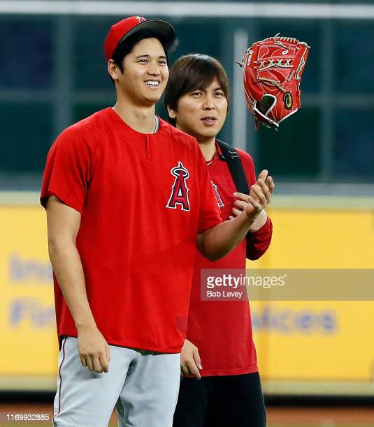 Shohei Ohtani of the Los Angeles Angels walks back to the dugout after warming up before a baseball game against the Houston Astros at Minute Maid...