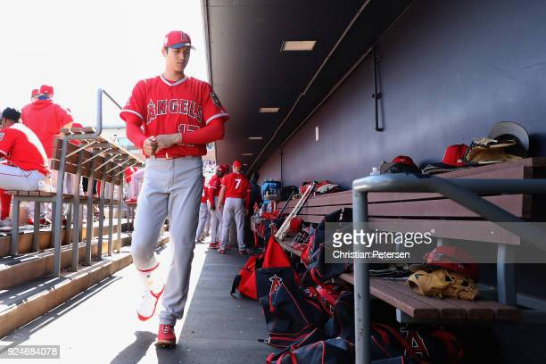Shohei Ohtani of the Los Angeles Angels walks in the dugout during the second inning of the spring training game against the San Diego Padres at...