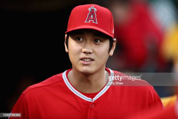 Shohei Ohtani of the Los Angeles Angels walks out to the field for their game against the Oakland Athletics at Oakland Alameda Coliseum on September...