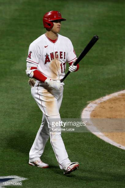 Shohei Ohtani of the Los Angeles Angels walks to home plate for his at-bat during a game against the Kansas City Royals at Angel Stadium of Anaheim...