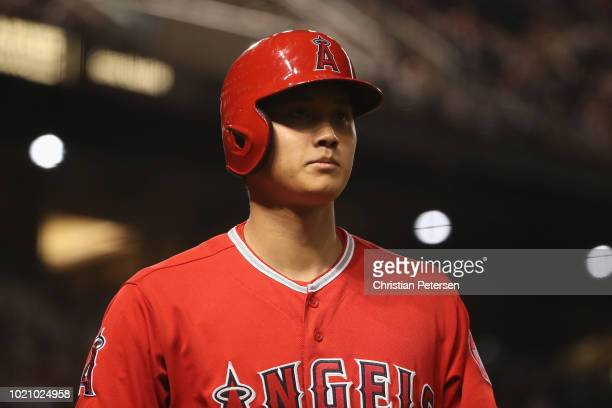 Shohei Ohtani of the Los Angeles Angels walks to the dugout during the seventh inning of the MLB game against the Arizona Diamondbacks at Chase Field...