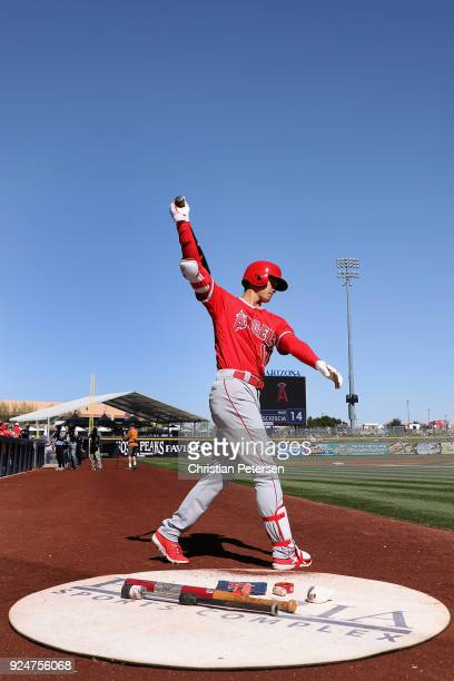 Shohei Ohtani of the Los Angeles Angels warms on deck during the spring training game at Peoria Stadium on February 26 2018 in Peoria Arizona