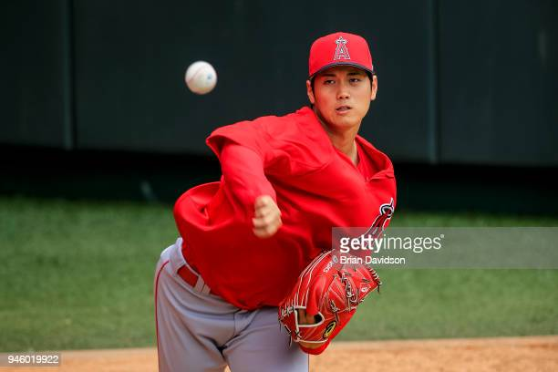 Shohei Ohtani of the Los Angeles Angels warms up before the game against the Kansas City Royals at Kauffman Stadium on April 13 2018 in Kansas City...