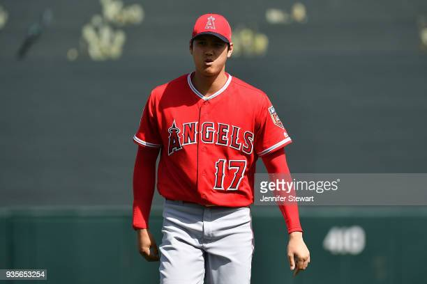 Shohei Ohtani of the Los Angeles Angels warms up prior to the spring training game against the Arizona Diamondbacks at Salt River Fields at Talking...