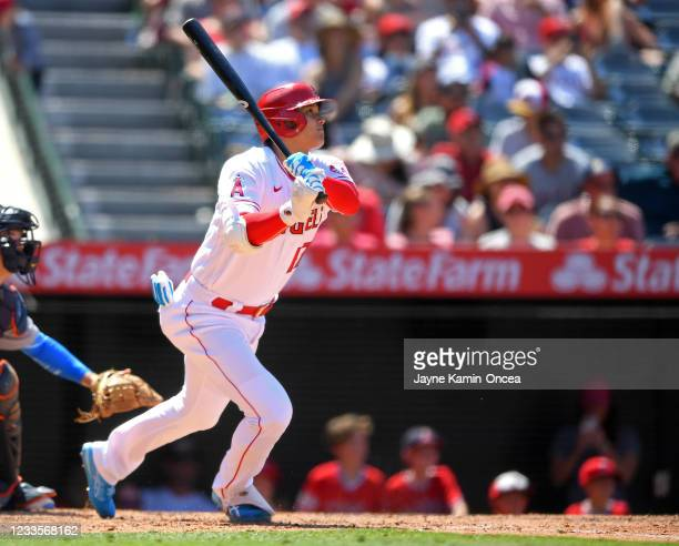 Shohei Ohtani of the Los Angeles Angels watches as the ball clears the wall on a two-run home run in the fifth inning of the game against the Detroit...