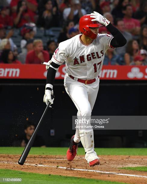 Shohei Ohtani of the Los Angeles Angels watches as the ball leaves the park on a two run home run in the third inning of the game against the Oakland...