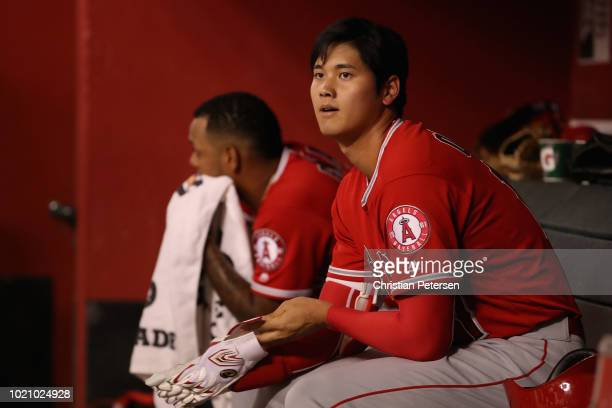 Shohei Ohtani of the Los Angeles Angels watches from the dugout during the seventh inning of the MLB game against the Arizona Diamondbacks at Chase...