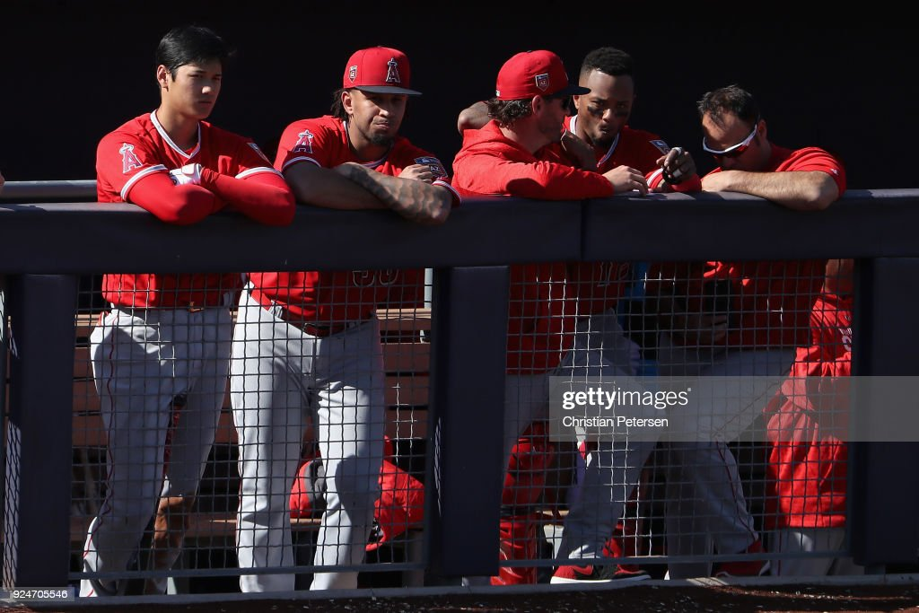 Shohei Ohtani #17 (L) of the Los Angeles Angels watches from the dugout during the third inning of the spring training game against the San Diego Padres at Peoria Stadium on February 26, 2018 in Peoria, Arizona.