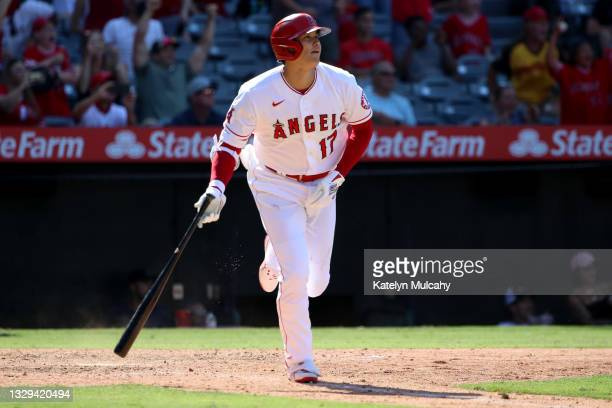 Shohei Ohtani of the Los Angeles Angels watches his two run home run during the ninth inning against the Seattle Mariners at Angel Stadium of Anaheim...