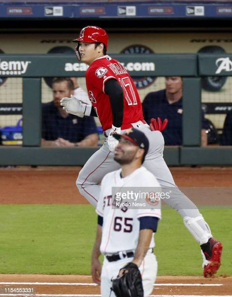 Shohei Ohtani of the Los Angeles Angels watches his tworun home run off Jose Urquidy of the Houston Astros in the third inning of a game at Minute...