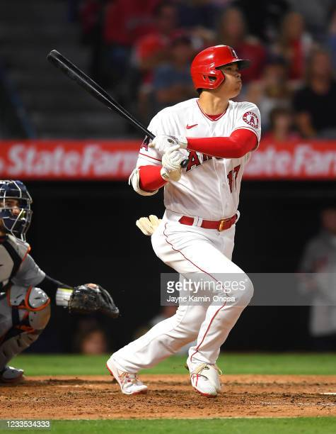 Shohei Ohtani of the Los Angeles Angels watches the ball clear the wall on a two run home run in the fifth inning of the game against the Detroit...