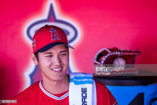 Shohei Ohtani pitcher of the Los Angeles Angels of Anaheim looks on before a game against the Milwaukee Brewers during a Spring Training Game at...