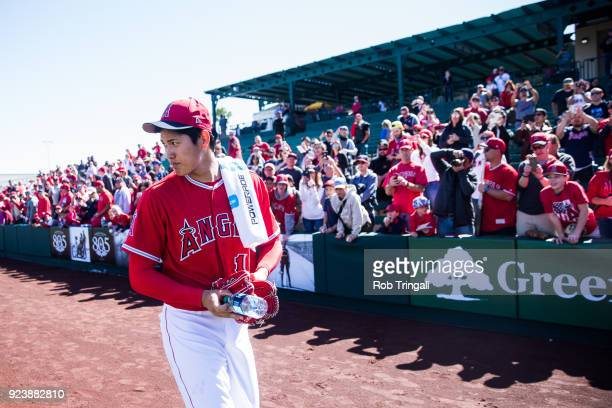 Shohei Ohtani pitcher of the Los Angeles Angels of Anaheim walks to the dugout before a game against the Milwaukee Brewers during a Spring Training...
