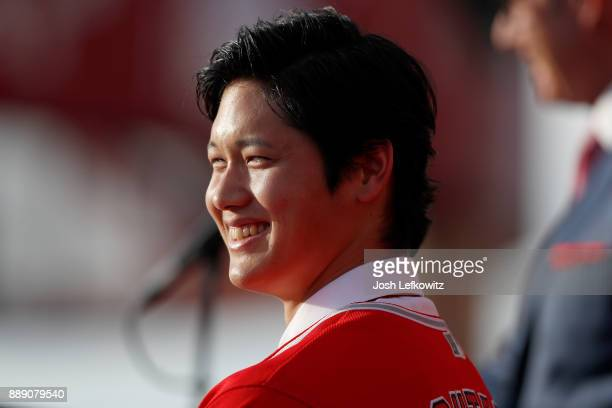 Shohei Ohtani speaks onstage during a press conference introducing Ohtani to the Los Angeles Angels of Anaheim at Angel Stadium of Anaheim on...