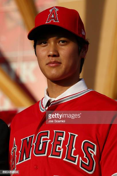 Shohei Ohtani speaks onstage during his introduceion to the Los Angeles Angels of Anaheim at Angel Stadium of Anaheim on December 9 2017 in Anaheim...