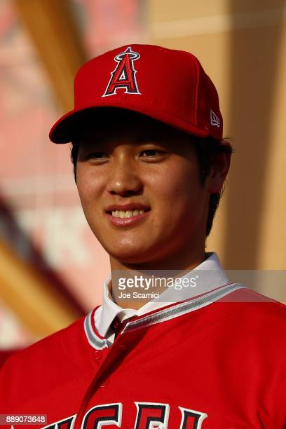 Shohei Ohtani speaks onstage during his introduction to the Los Angeles Angels of Anaheim at Angel Stadium of Anaheim on December 9 2017 in Anaheim...