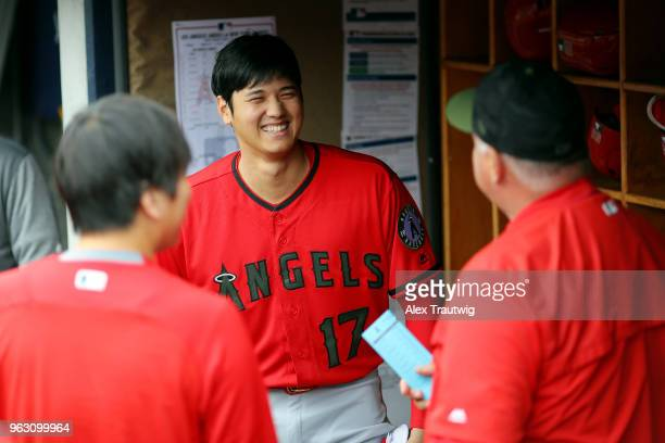 Shohei Ohtani speaks with manager Mike Scioscia of the Los Angeles Angels in the dugout ahead of a game against the New York Yankees at Yankee...