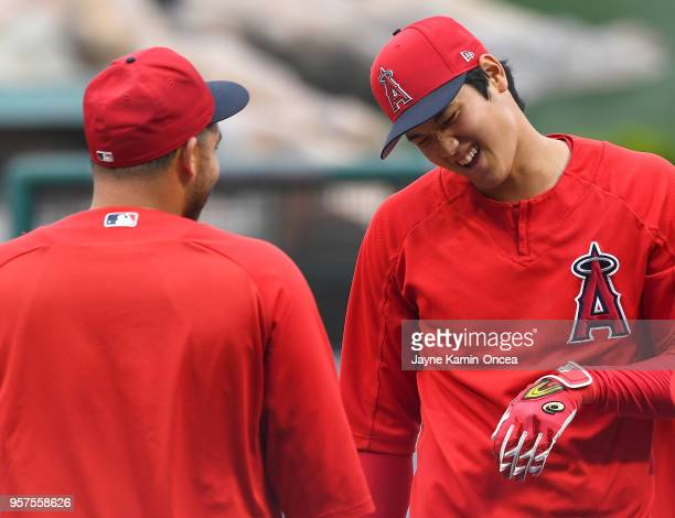 Shohei Ohtani talks with Rene Rivera of the Los Angeles Angels of Anaheim during practice before the game against the Minnesota Twins at Angel...