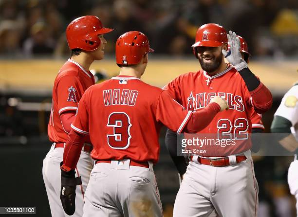Shohei Ohtani Taylor Ward and Andrelton Simmons congratulate Kaleb Cowart of the Los Angeles Angels after he hit a grand slam home run in the sixth...