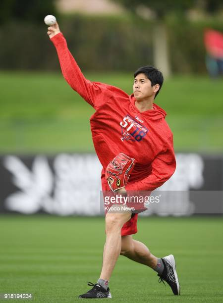 Shohei Ohtani throws the ball at the Los Angeles Angels' spring training site in Tempe Arizona on Feb 13 2018 ==Kyodo