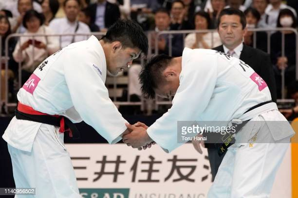 Shohei Ono and Masashi Ebinuma shake hands after the Men's 73kg semi final match during day two of the All Japan Judo Championships By Weight...