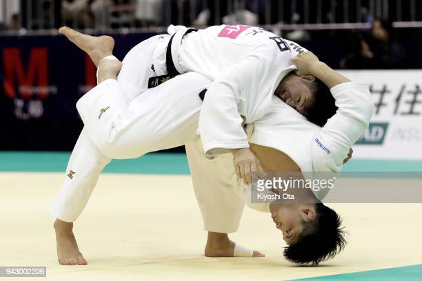 Shohei Ono attempts to throw Yuhei Yoshida in the Men's 73kg match on day one of the All Japan Judo Championships by Weight Category at Fukuoka...