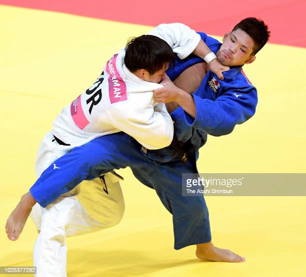 Shohei Ono of Japan and An Changrim of South Korea compete in the Judo Men's 73kg final at the Jakarta Convention Center on day twelve of the Asian...