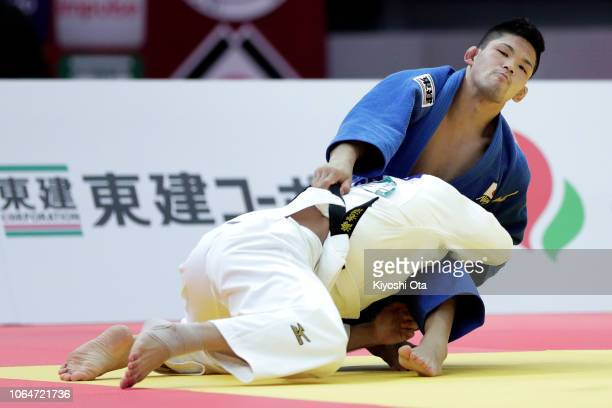Shohei Ono of Japan competes against Masashi Ebinuma of Japan in the Men's 73kg final match on day two of the Grand Slam Osaka at Maruzen Intec Arena...
