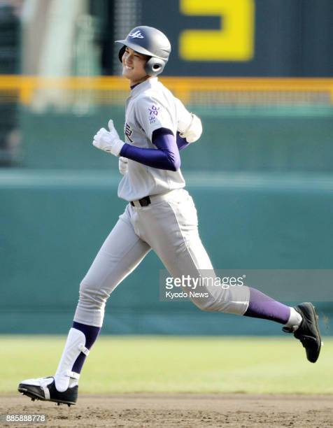Shohei Otani a pitcher of Hanamaki Higashi High School rounds the bases after hitting a home run during a national high school tournament game at...