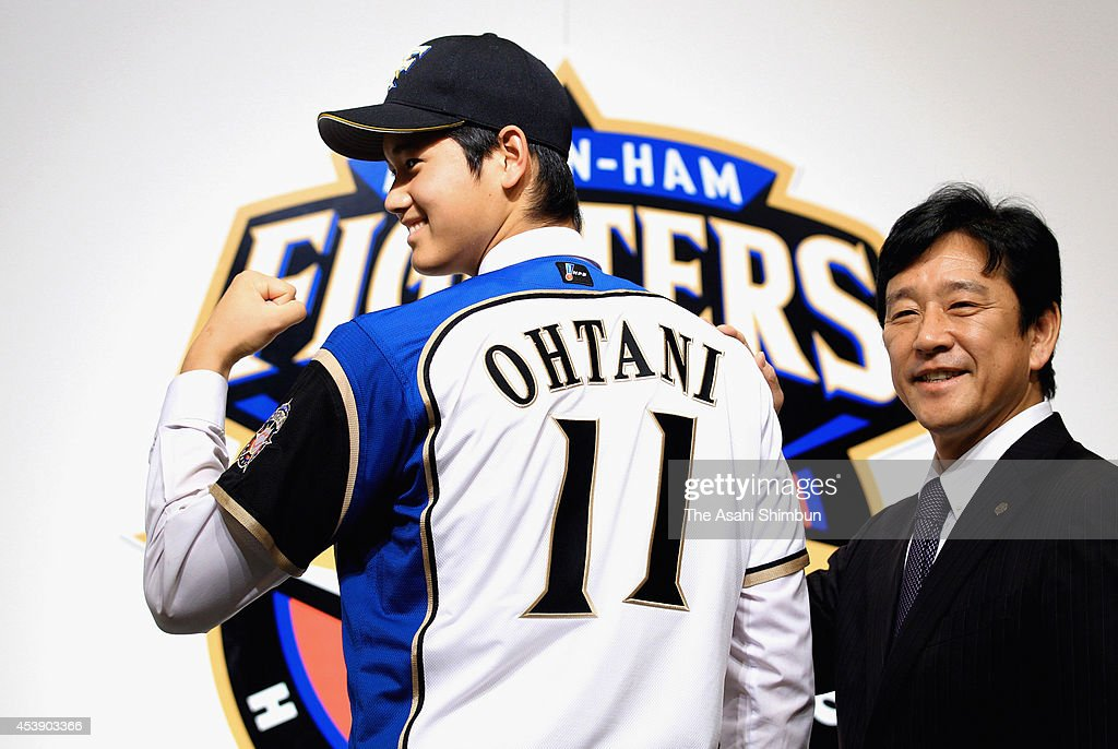 Shohei Otani and Hokkaido Nippon-Ham Fighters Manager Hideki Kuriyama pose for photographs during the press conference to announce Shohei Otani signing with the Hokkaido Nippon-Ham Fighters on December 25, 2012 in Sapporo, Japan.