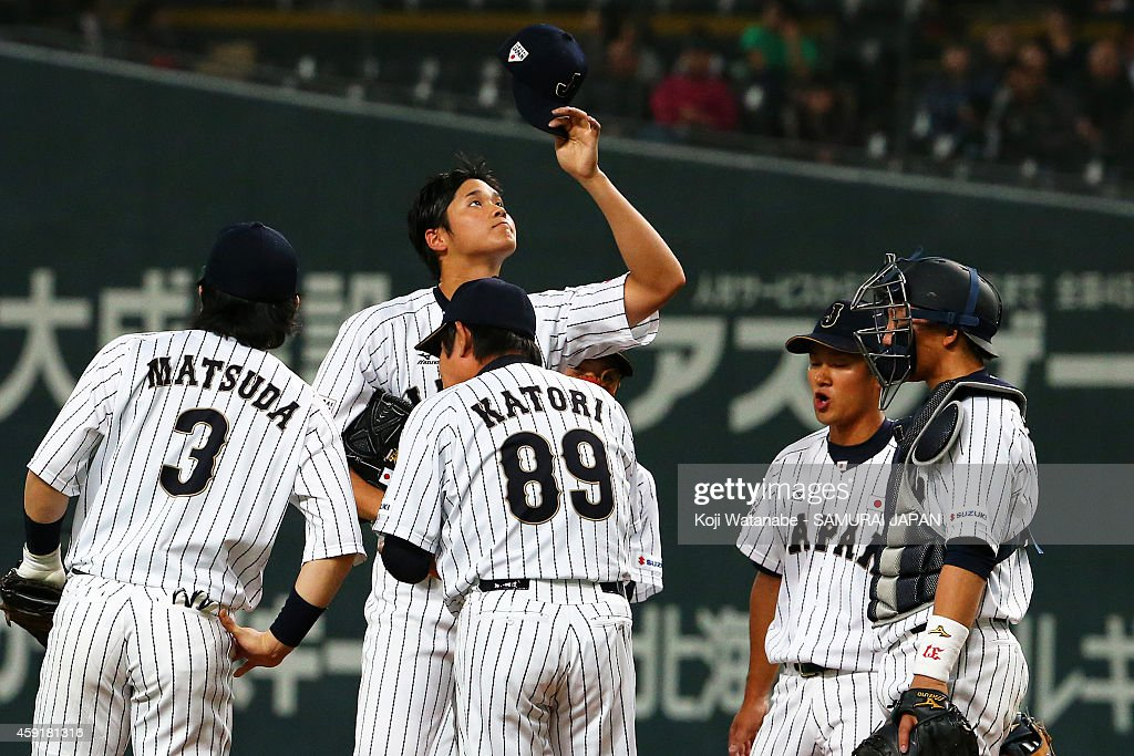 Shohei Otani #16 and Samurai Japan gather at the mound with pitching coach during the game five of Samurai Japan and MLB All Stars at Sapporo Dome on November 18, 2014 in Sapporo, Hokkaido, Japan.