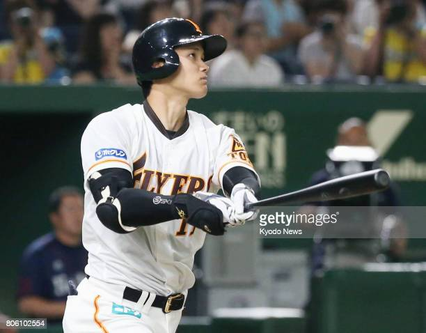 Shohei Otani hits a double in the fourth inning of the Nippon Ham Fighters' 114 loss to the Seibu Lions at Tokyo Dome on July 3 2017 The twoway...