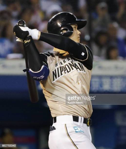Shohei Otani hits a tiebreaking solo home run in the eighth inning of the Nippon Ham Fighters' 43 win over the Lotte Marines at Zozo Marine Stadium...