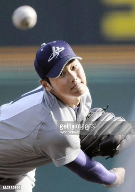 Shohei Otani of Hanamaki Higashi High School pitches in national high school tournament game at Koshien Stadium Hyogo Prefecture on March 21 2012...