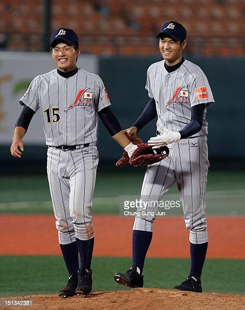 Shohei Otani of Japan celebrates with his team mate Fumiya Hojo after the 18U Baseball World Championship match between Japan and South Korea at...