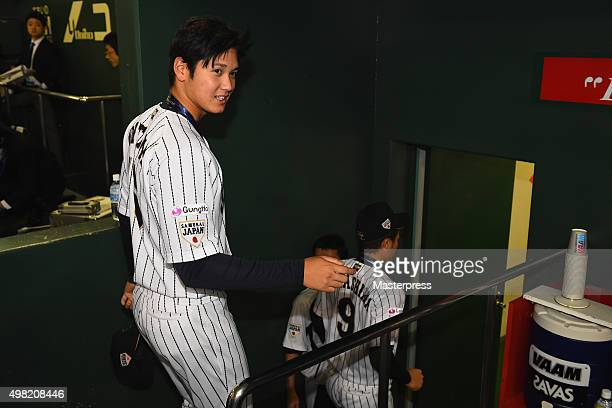 Shohei Otani of Japan is seen in the bench after winning the WBSC Premier 12 third place play off match between Japan and Mexico at the Tokyo Dome on...