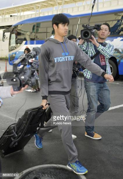 Shohei Otani of the Nippon Ham Fighters arrives at Naha airport in Japan's southern island prefecture of Okinawa on Feb 12 ahead of the team's...