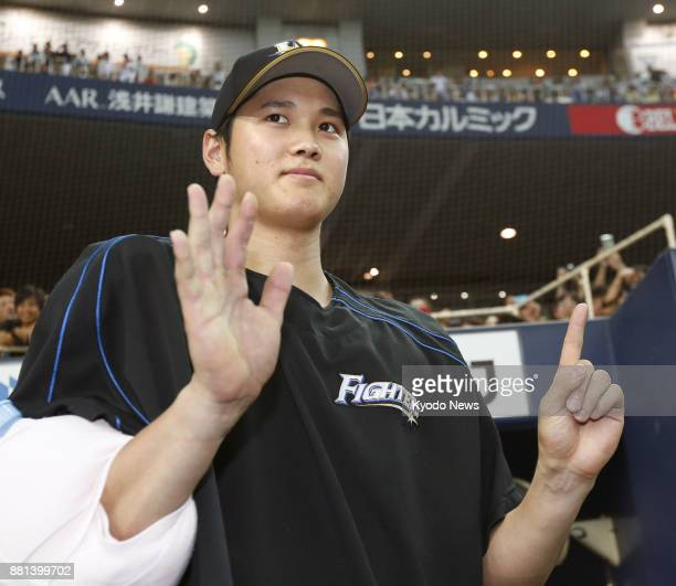 Shohei Otani of the Nippon Ham Fighters celebrates his 15th win of the 2015 season after striking out 12 over eight innings against the Orix...