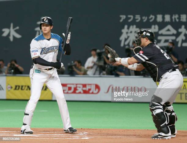 Shohei Otani of the Nippon Ham Fighters draws an intentional walk in Game 2 of the Pacific League Climax Series final stage against the SoftBank...