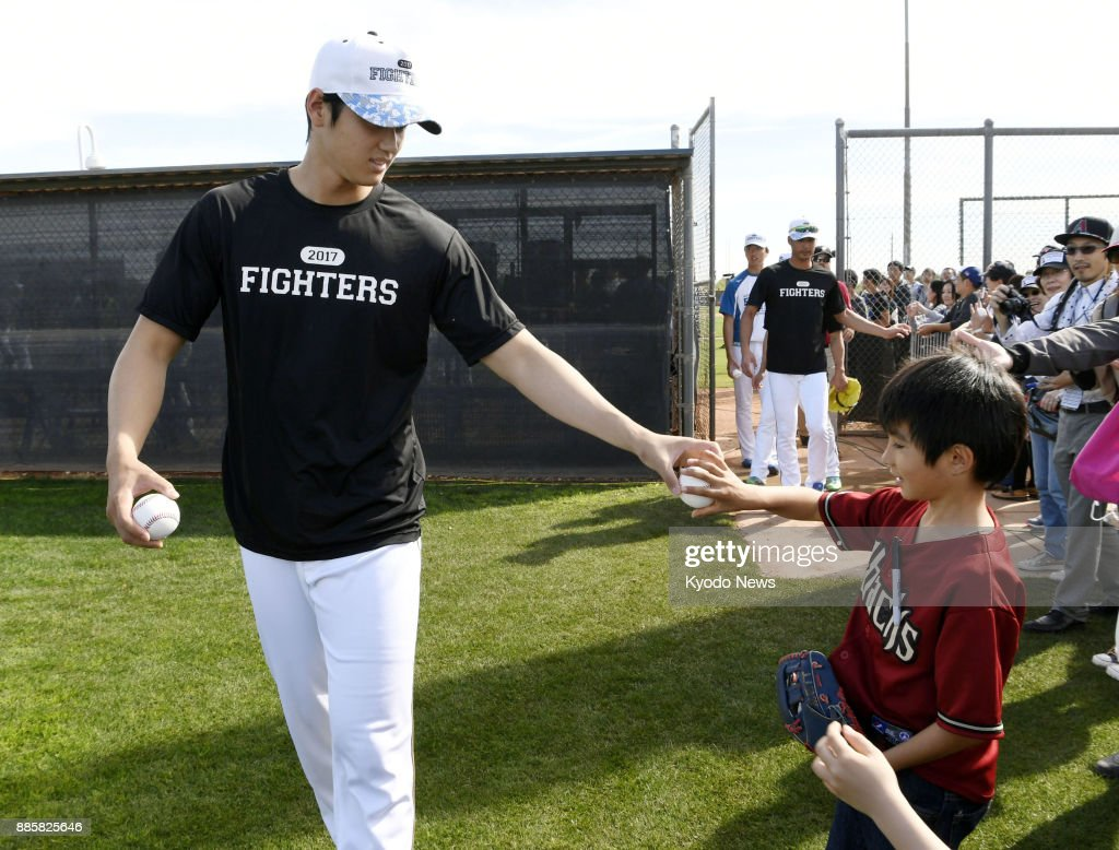 official photos e2cc7 d12d1 Shohei Otani of the Nippon Ham Fighters gives away a ball to ...