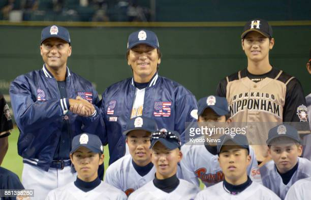 Shohei Otani of the Nippon Ham Fighters poses for a picture with former New York Yankees players Derek Jeter and Hideki Masui during a charity event...