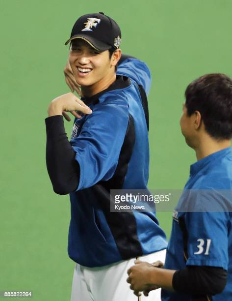 Shohei Otani of the Nippon Ham Fighters relaxes during training at Sapporo Dome in Hokkaido on March 30 2017 ==Kyodo