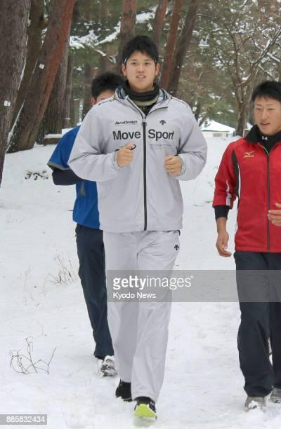 Shohei Otani of the Nippon Ham Fighters trains at his alma mater Hanamaki Higashi High School in Hanamaki Iwate Prefecture on Jan 3 2014 ==Kyodo