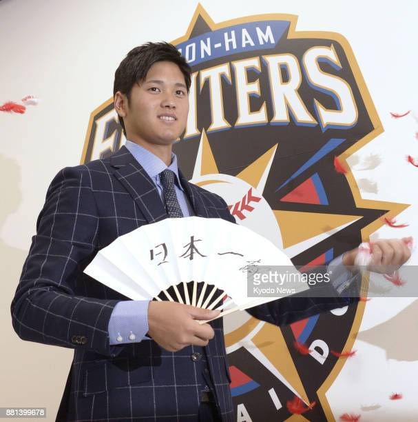 Shohei Otani poses for a photo after signing a 100 million yen contract ahead of his third season with the Nippon Ham Fighters on Dec 5 at the...